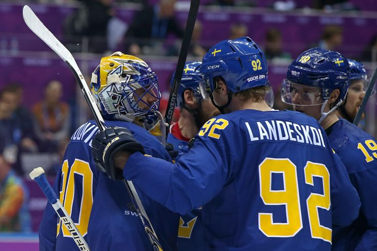 Henrik Lundqvist #30 of Sweden celebrates with his teammate Gabriel Landeskog #92 after defeating the Czech Republic 4 to 2 in the Men's Ice Hockey Preliminary Round Group C game (c) Getty Images