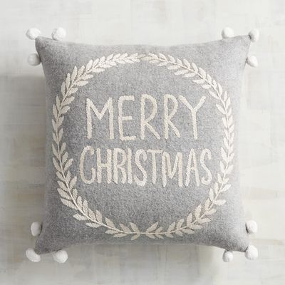 Merry Christmas! Our decorative pompom-embellished pillow features a sentiment to share with your family and friends, wreathed in intricate embroidery. 'Tis the season for your sofa to shine.