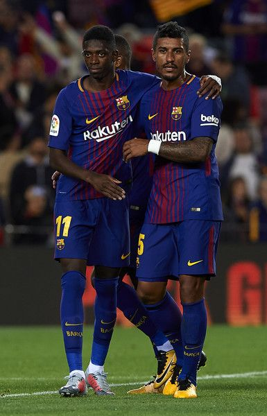 Ousmane Dembele (L) and Paulinho of Barcelona celebrate after the La Liga match between Barcelona and Espanyol at Camp Nou on September 9, 2017 in Barcelona.