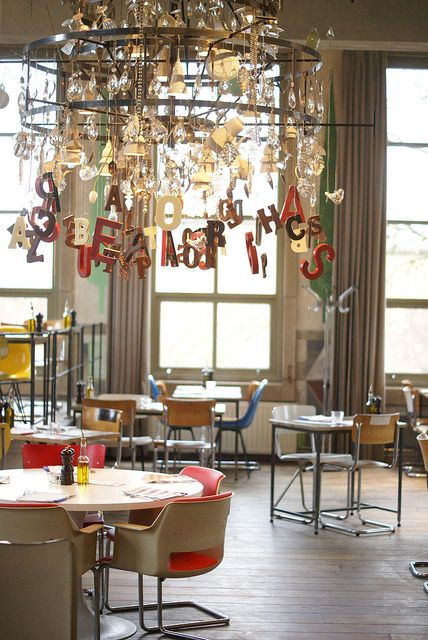 Letter chandelier! @Jessi Parrett Peterson, could we do this with a hula hoop and various letters and shapes haging off of it? Or... (idea coming)... over each table this summer with beachy shapes!