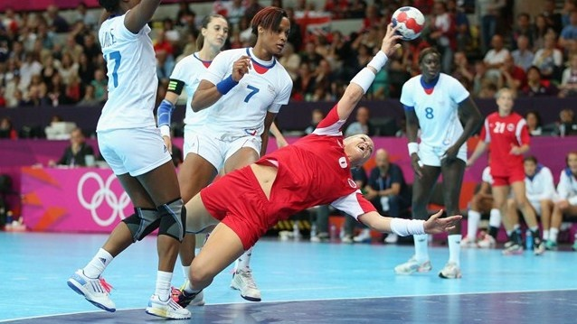 Heidi Loke of Norway scores a goal in the women's Handball preliminary group B match between Norway and France on Day 1 of the London 2012 Olympic Games at the Copper Box on 28 July 2012.