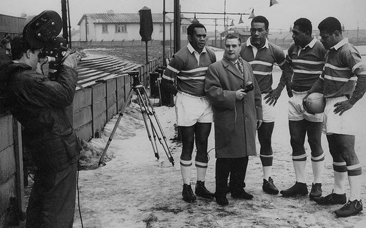 Orsi Dawai (third from left) and Joe Levula (second from right) are interviewed with fellow Fijians Voate Drui (left) and Liatia Ravouvou, at Rochdale in 1963