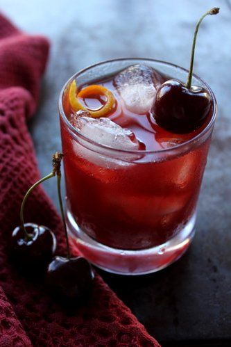 sweet cherry mahattan | 6-8 sweet cherries, stemmed and rinsed, plus 1 for garnish 2 ounces rye or bourbon whiskey 3/4 ounce sweet, red vermouth 4 drops Angostura bitters ice orange twist  In a tall, thin vessel, such as a cocktail shaker, muddle the cherries to a juicy pulp. Add the whiskey, vermouth and bitters, stir, and strain into a rocks glass over ice, pressing on the pulp to extract as much liquid as possible