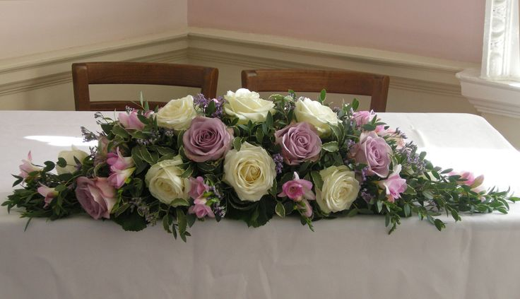Charming Ceremony Table Flower Arrangement Of Ivory Avalanch Roses, Dusky Lilac  Roses, Memory Lane,