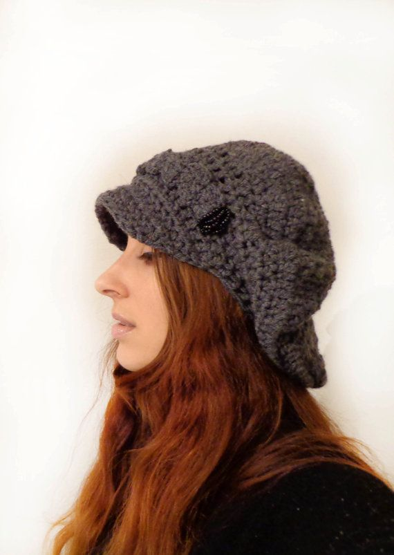 Handmade newsboy slouchy hat from wool blend yarn, very soft, comfortable and warm.  I add black glass beads in the front, something different than other hats and beautiful.  This hat is grey in color.  Hand wash in cold water and lay flat to dry for best care.      Plus with each item purchase i will give a small gift!