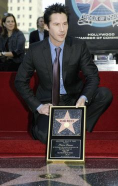 Keanu Reeves with his star on the Hollywood Walk of Fame