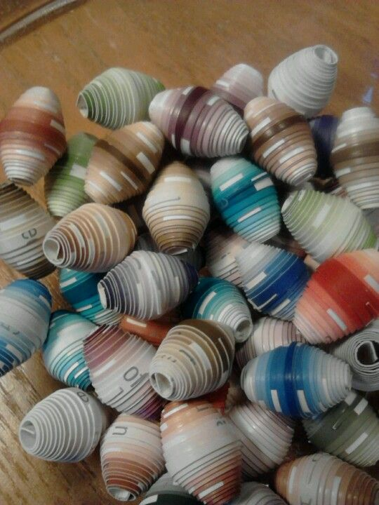 Paper Beads recycled from paint sample cards ... going to make an awesome bracelet, necklace and earring set ...