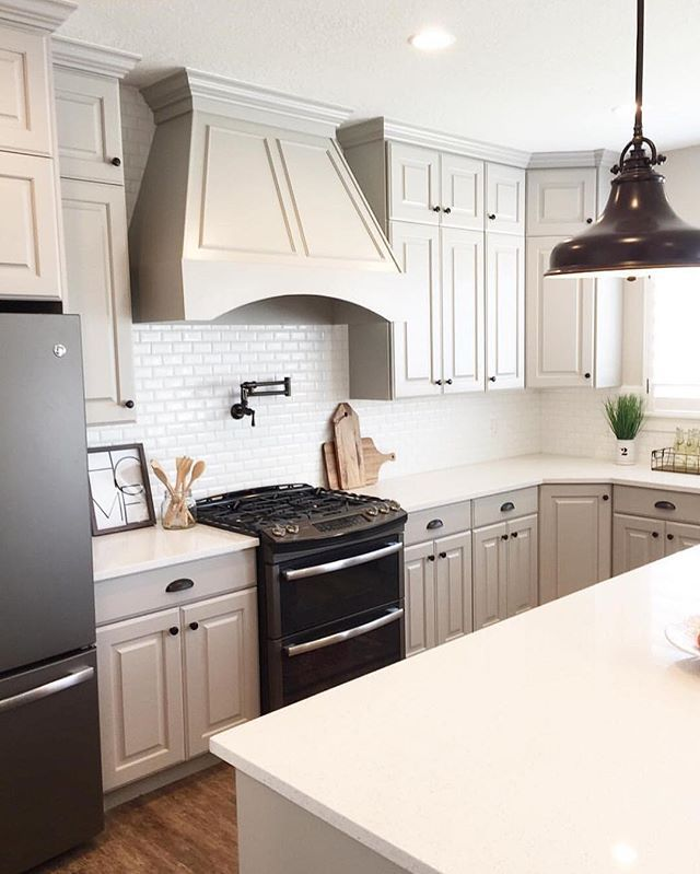 obsessed with this kitchen posted by @remodelaholic...I have been wanting to lighten our kitchen but don't want white cabinets...the light gray & white counter combo is perfectly paired with black accents & subway tile...plus I've had my eye on those slate appliances for awhile now! I could see this in our home! ❤️ #swoonworthysaturday