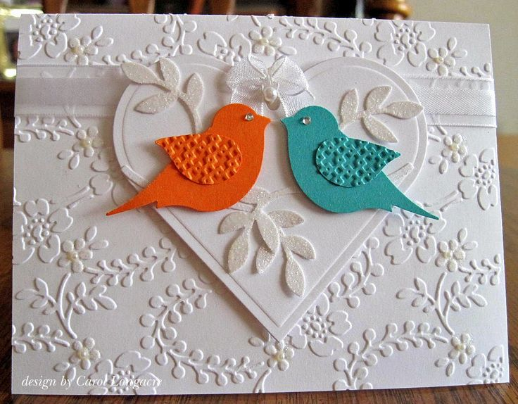 handmade wedding card from Our Little Inspirations: Wedding Birds ... two step bird punch birds in orange and aqua ... like the embossing folder texture on the wings and bling for the eyes ... gorgeous Anna Griffith embossing folder flowers and leaf tendrils on main panel ... glittered flowers and leaves  wonderful card!