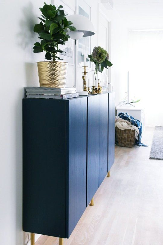 Inventive Ways to Use IKEA's IVAR All Over the House Adding legs, then painting it blue, turns IVAR cabinets into a dining room credenza that looks chic and functional in Caterina's home.