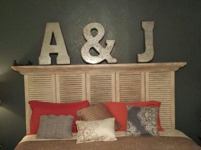 Ok I know everyone is doing the shutter headboards now and I love them so I finally finished my own! :-D so proud.  These were actually PLASTIC cheap shutters I got at habitat for Humanity and since they were so long I only had to buy 3 and cut them in half.  I added the decorative trim then distressed painted the whole thing. :-) proud of myself. My dad helped too! #shutterheadboard