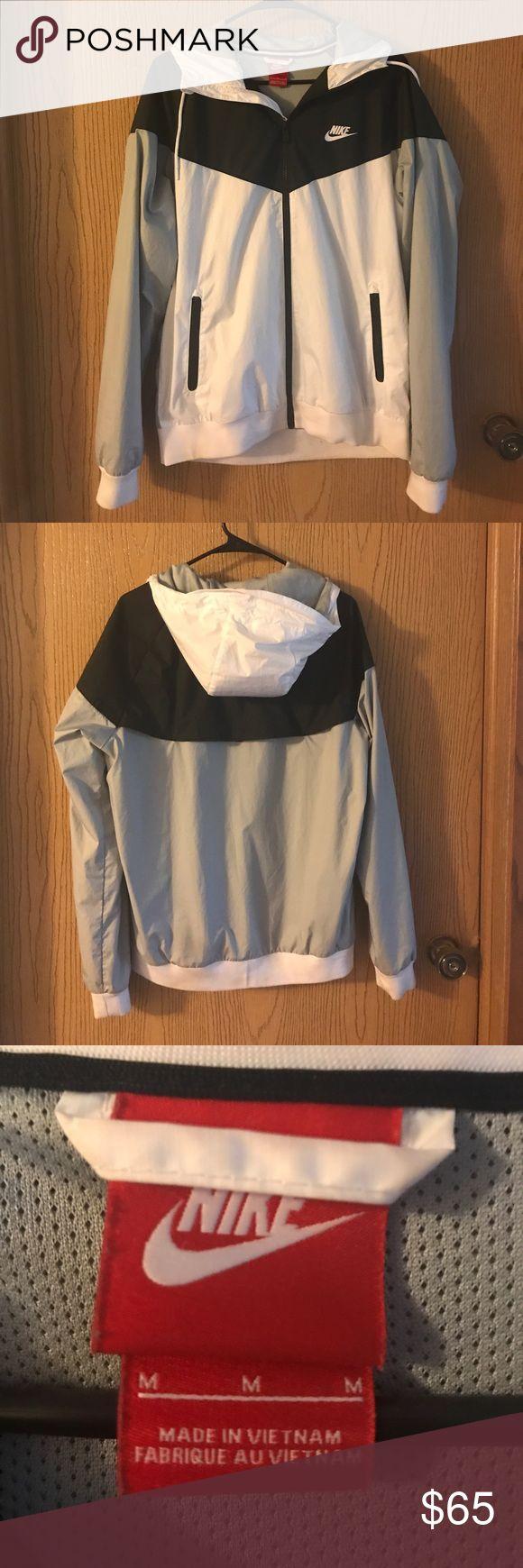 Nike Rain Jacket Black, white, and grey Nike rain jacket. Very good condition Nike Jackets & Coats