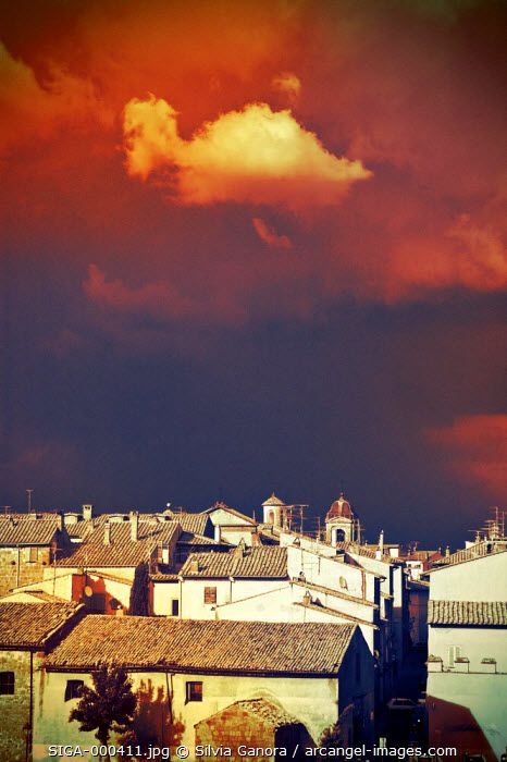 Cloud over Italian village with moody light and colors. Approaching storm. - ©Silvia Ganora Photography - All Rights Reserved  #bookcovers #clouds #italy