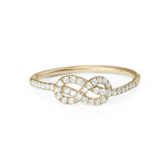 Mini Infinity love knot pave white diamond ring ♥ Thin and dainty design. ♥ Materials: 14k /18k solid gold, ♥ Ring made from 14k or 18k solid gold. CAN be made in white gold / yellow gold / rose gold. Choose in listing options. ♥ 0.20ct F / VS Conflict Free. ♥ Knot Width 5.5mm,