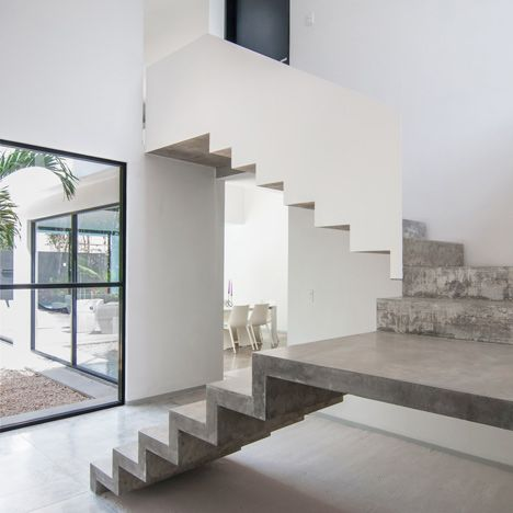 A precast staircase is one of several concrete elements added to this house in Mexico.