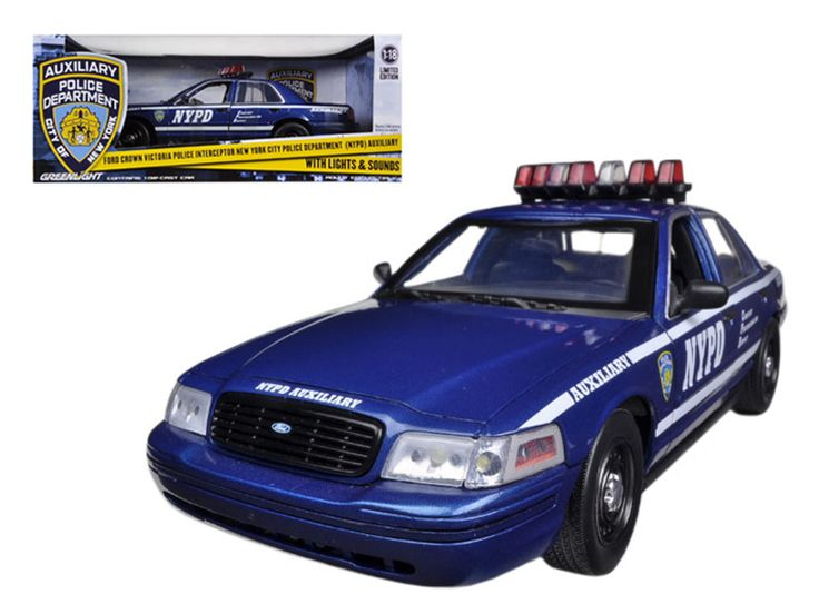 2001 Ford Crown Victoria NYPD Car Blue Auxiliary Interceptor With Lights and Sounds 1/18 Diecast Car Model by Greenlight - Brand new 1:18 scale car model of 2001 Ford Crown Victoria NYPD Car Blue Interceptor With Lights and Sounds diecast car model by Greenlight. http://www.youtube.com/watch?v=n4ByyrTQ2cY. Opening doors, hood. Rubber tires. Brand new box. Has steerable wheels. Requires 3 AAA batteries. Has opening hood and doors. Detailed interior, exterior, engine compartment. Dimensions…