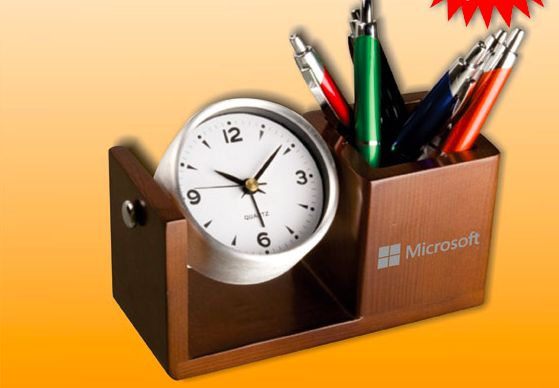 Elegant aluminium desk clock with rotating function and an integrated pen holder in a wood finish. Is an eye catcher on every desk. R95 Excl Vat