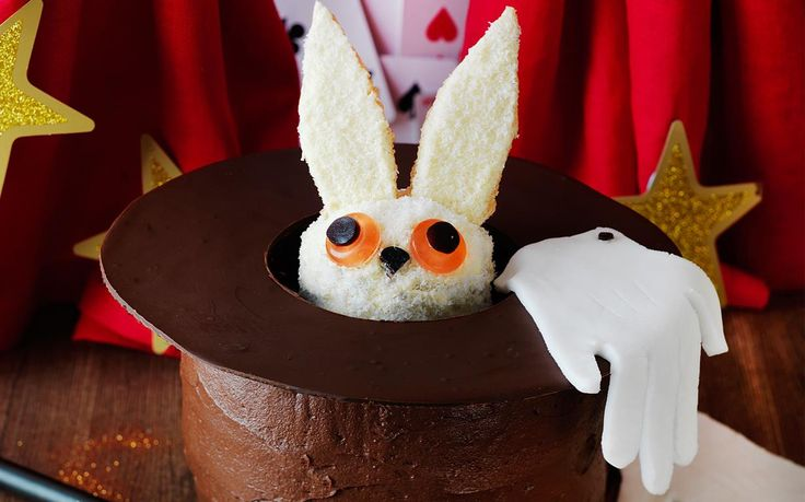 What's inside the magicians hat? Abracadabra the rabbit! This cake is perfect for little magicians and magic themed birthday parties.