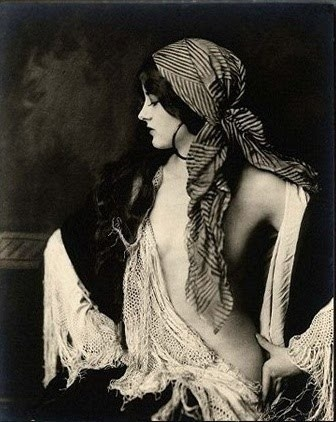 Gypsy woman, so very poised.
