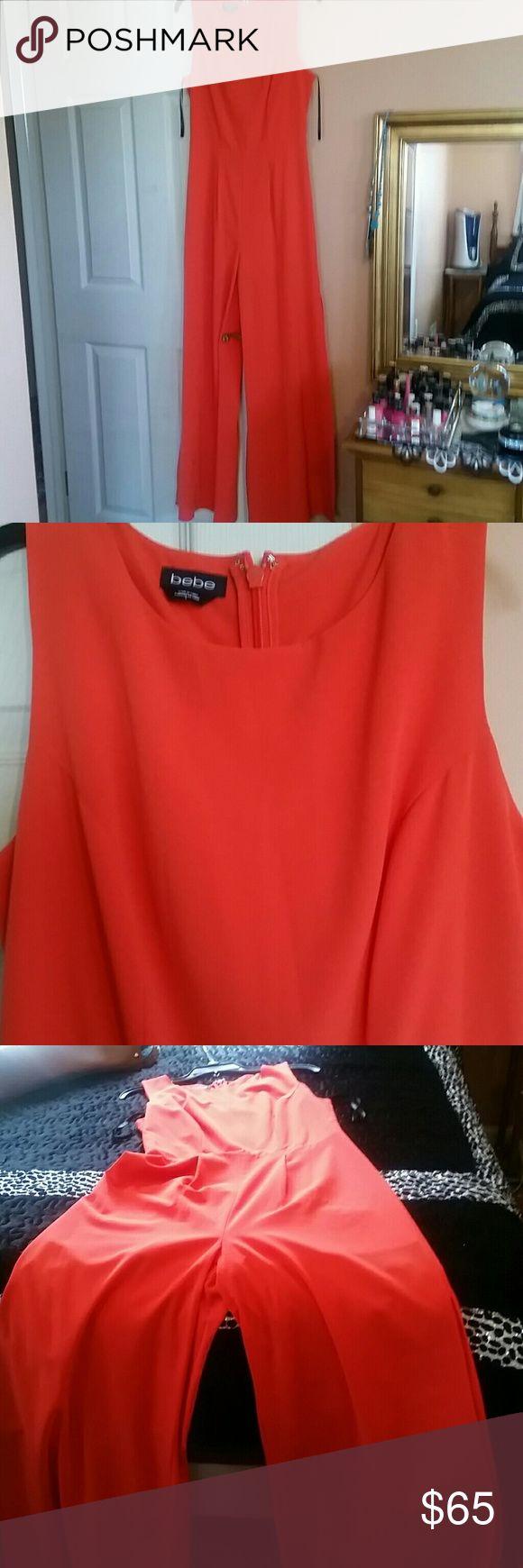 New bebe jumpsuit. Orange jumpsuit  from bebe.open on side bebe Other