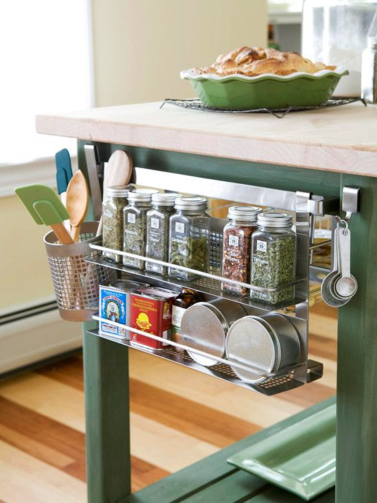 A hanging shelf keeps frequently-used spices in an easy-to-reach place. See 16 more kitchen organizing ideas: http://www.bhg.com/kitchen/storage/organization/kitchen-storage-solutions/?socsrc=bhgpin091512islandshelfstorage=8
