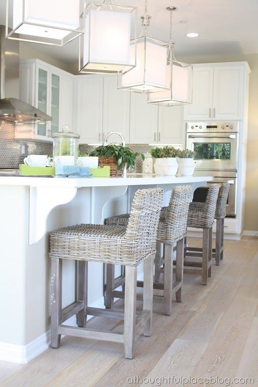 Well hello dream kitchen. Love the textured barstools with the beautiful pendants. & Best 25+ Wicker bar stools ideas on Pinterest | Coastal inspired ... islam-shia.org