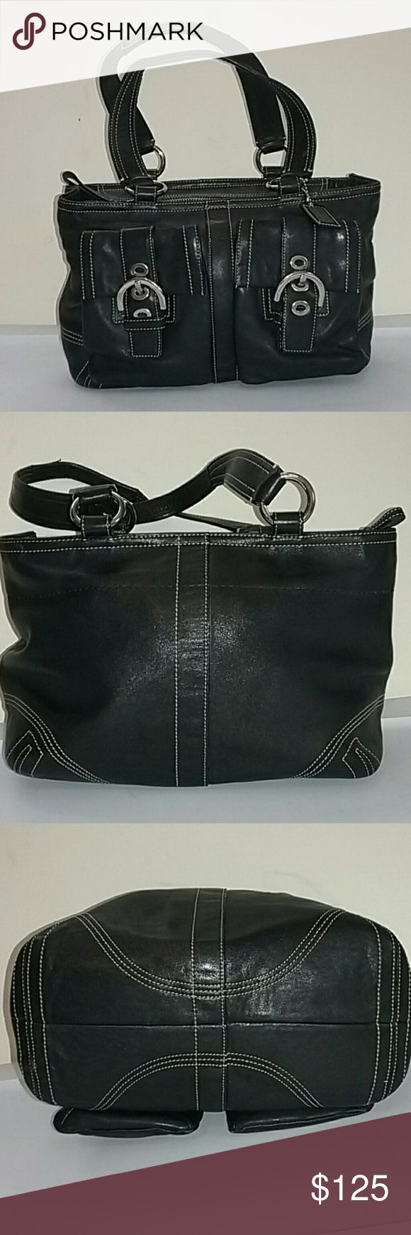 """Coach Black Leather Soho Double Pocket Satchel Coach black leather satchel with Double buckle front pockets (buckles hide easy to access  magnetic snap pockets big enough for many cell phones).  Approximately 11"""" x 8"""" x 4.5"""". Strap stop 7"""".  Two interior slip pickets and one interior zippered pocket.  Snaps on side near ends of top zipper. EUC. Very slight signs of use on ring hardware,  no other issues.  Very nice bag! Feel free to make an offer! Coach Bags Satchels"""