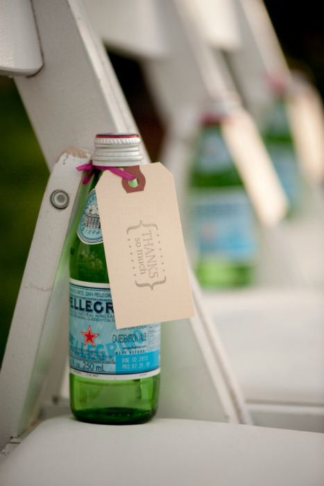 For a summer/outdoor wedding a chilled bottle of water at every seat is a great idea. Source: jenniferdavis #welcomegift #outdoorwedding