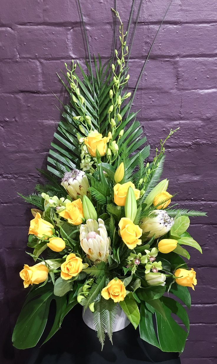 Symmetrical bowl arrangement @Lauren Alyce Floral Design Lauren Alyce Floral Design Roses, lilies, orchids, monsterea, Palm, proteas
