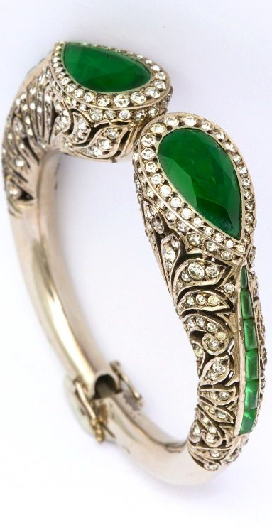 """1920s Elegant Art Deco French Paste Bracelet. A grand piece of 1920s Art Deco """"traveling jewelry"""" made in the style of fine jewelry. A silver and French paste bracelet imitating diamonds and emeralds. Spring closure, with 2 original safeties. French silver and maker marks. Completely closed fits a 6 1/2 inch wrist. Excellent condition."""