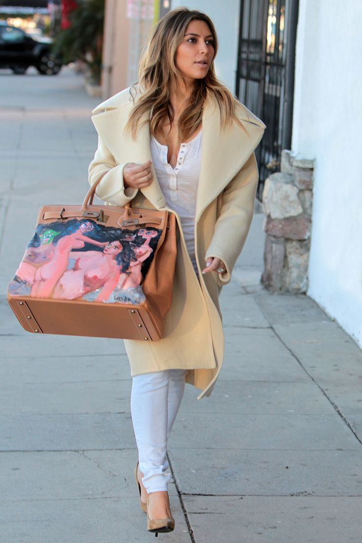 The budding tech entrepreneur received her George Condo–painted Birkin from then-fiancé Kanye West. While the general public had mixed reactions to the bag, that was only further proof that Mr. West had given his fiancée a truly wearable piece of art. - Photo: MAP/Splash News
