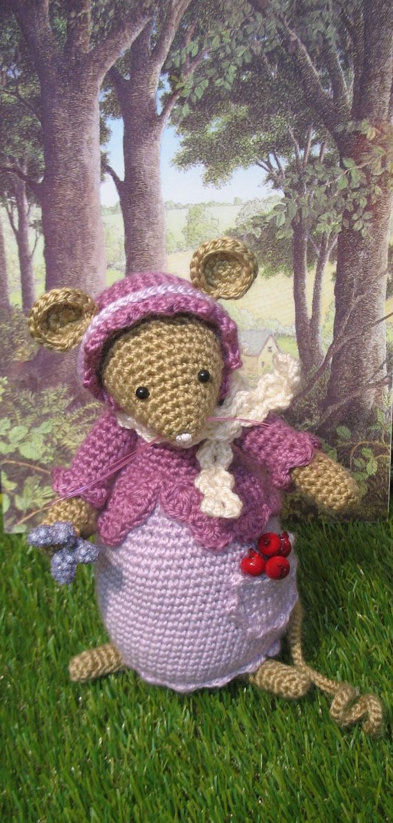 This is Primrose.  Primrose is a crochet mouse inspired by the lovely stories of Brambly Hedge.  She measures almost 8 inches.  She is