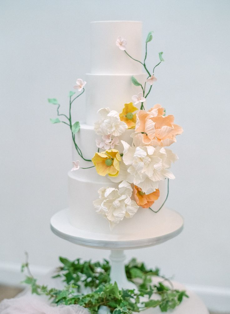 wedding cake with sugar flowers - photo by Wedding Nature Photography http://ruffledblog.com/modern-indoor-garden-wedding-inspiration