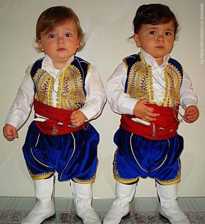 Υoung twin boys with traditional Cretan costume
