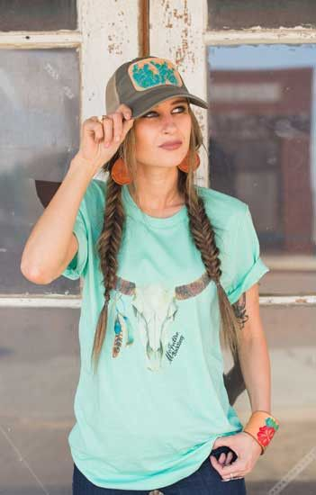 Add a pop of color to your summer wardrobe with the Mint Cowskull T-Shirt