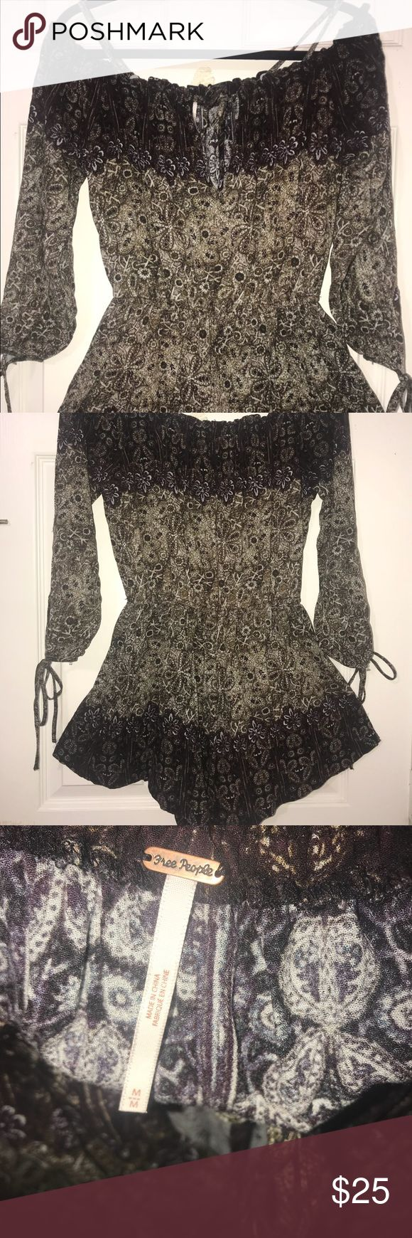 Free People Junior Romper size Medium Used once. In great condition. It is a pull over style with an elastic waste and tie sleeves. Can we worn off the shoulder or with straps. Shorts have lining. Comes from a Pet Free / Smoke Free Home. Free People Dresses Mini