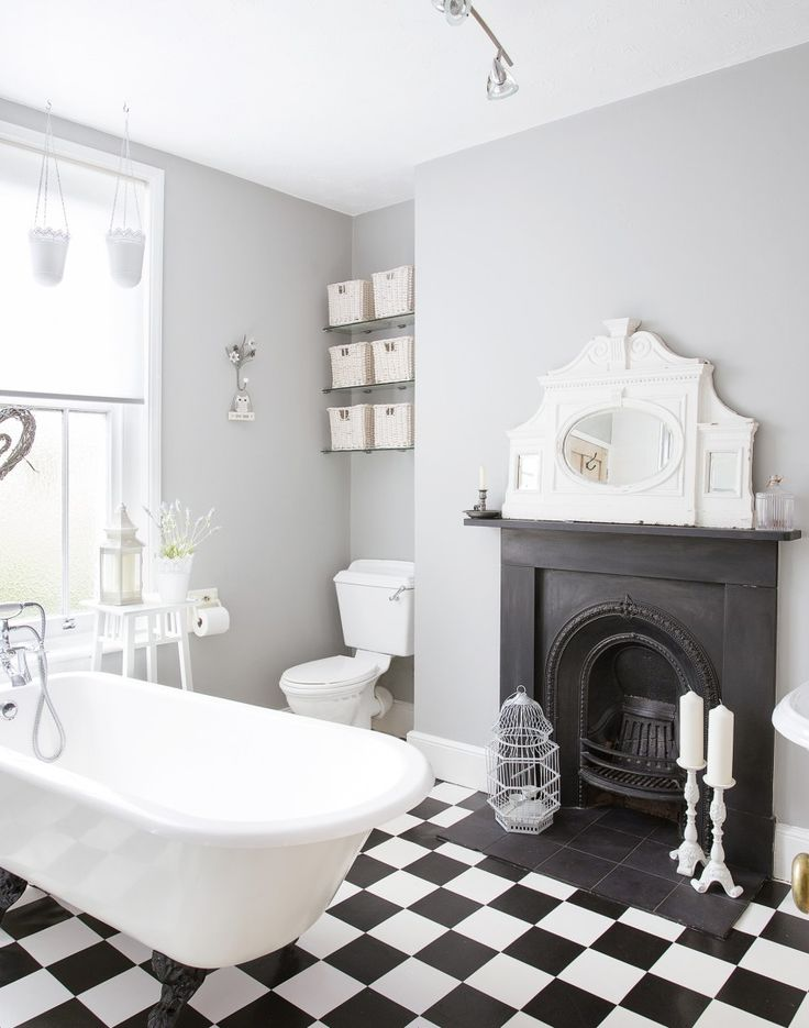 If you're lucky enough to have a fireplace in your bathroom, then use this a starting point for traditional decorating schemes. This simple monochrome finish has high impact, and the fireplace finishes the room perfeclty.