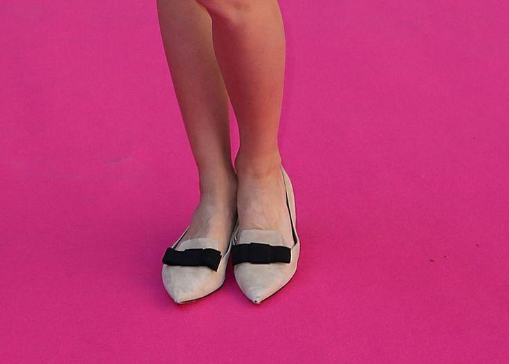 No heels? No problem. Olivia's Dior bow flats are just as cute!