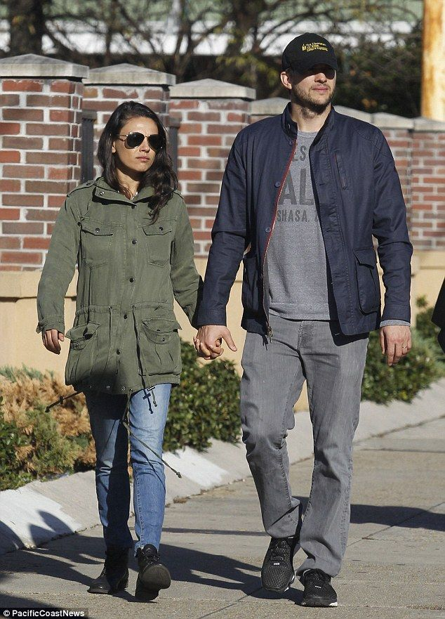 Hand-in-hand: Mila Kunis enjoyed a hand-holding walk with husband Ashton Kutcher in New Or...