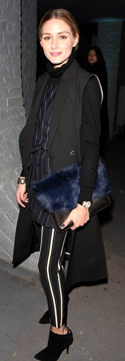 Olivia Palermo: Sunglasses – Dior  Shirt, purse, and pants – Topshop  Sweater – Tibi  Shoes – Tabitha Simmons