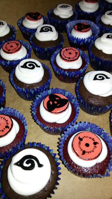 Naruto and sharingan red velvet and chocolate cupcakes. Maybe not red velvet..