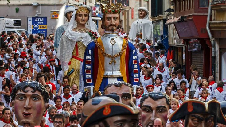"""Pamplona's running of the bulls  -  A parade of """"gigantes y cabezudos"""" (giants and big-headed puppets) as part of the Fiesta de San Fermin in Pamplona, Spain, on July 7, 2017."""