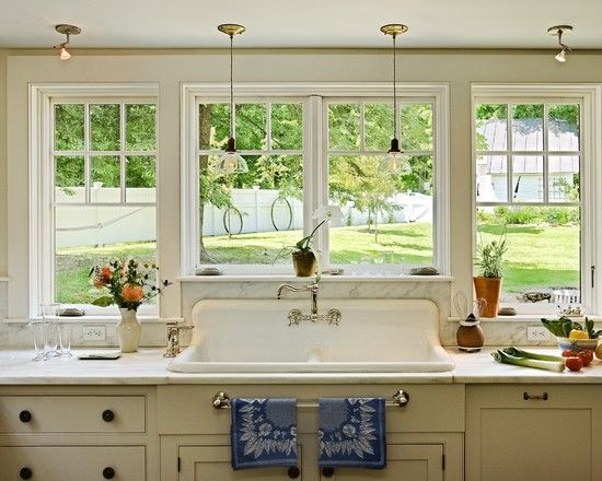 large window across kitchen, no upper cabinets