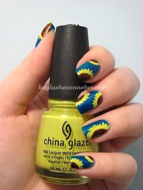 Super sunflower nail art. http://www.ivillage.com/floral-nail-art-nail-designs-diy/5-a-534508