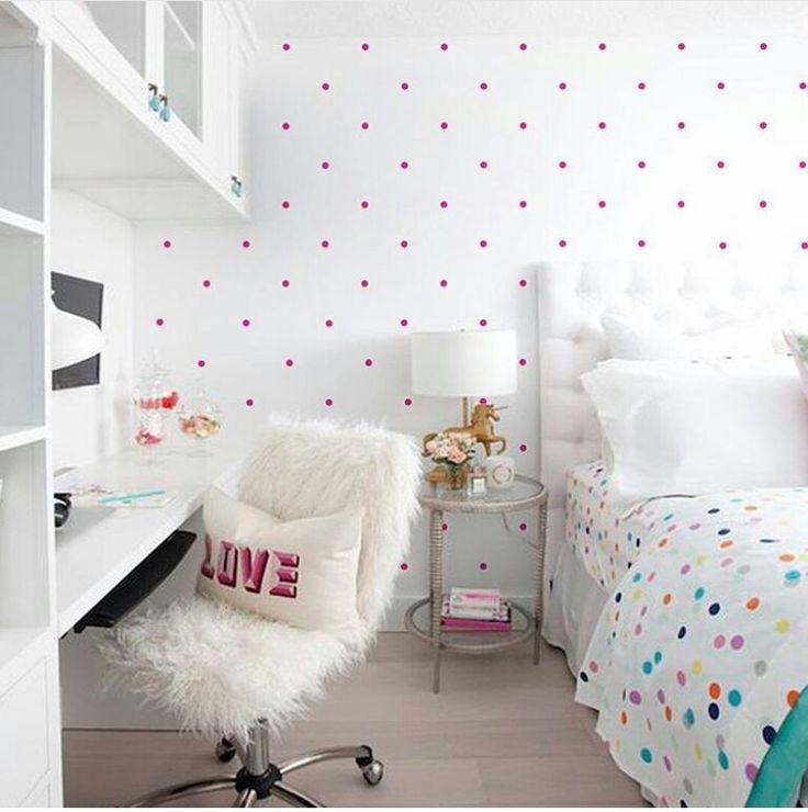 Pink polka dot room with multicolored polka dot sheets