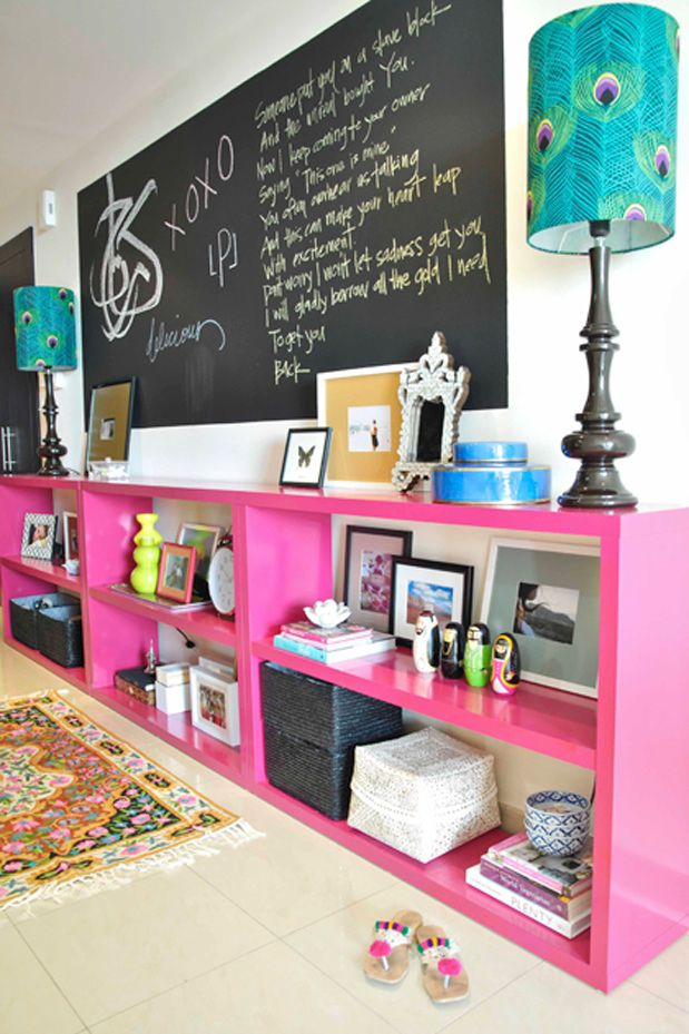 Family room/ play room inspiration. White walls, chalkboard, pink shelves, turquoise accents.