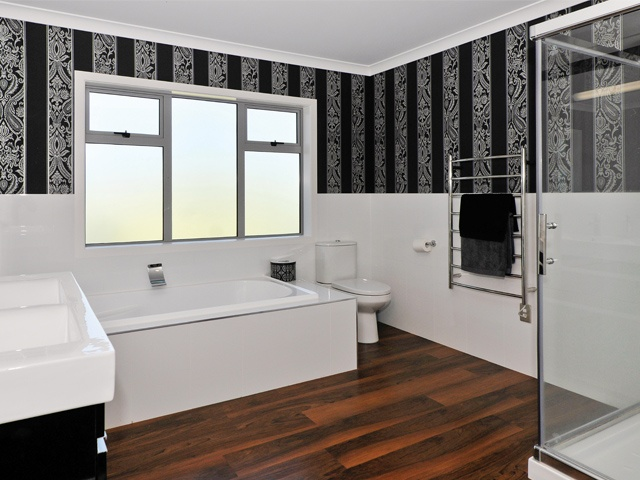 The home's beautifully finished and spacious bathrooms complete the relaxing experience.