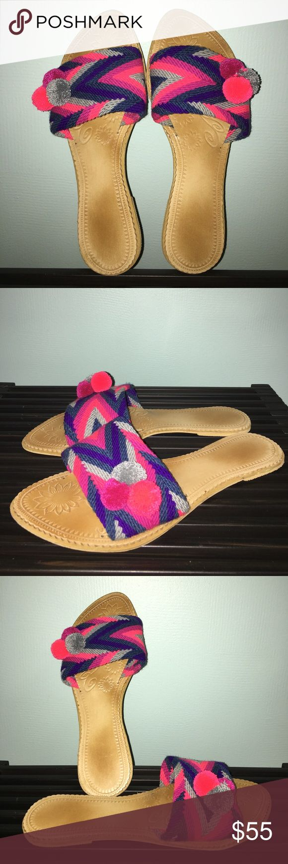 Multicolors pompom flat slide sandals Run small. Please order a size up. Price firm. Won't be reestocked. No holds. Beautiful to the beach and summer. Available only in whole sizes! If you're a half size order a size up. Handmade by colombian indigenous wayuù. handmade Shoes Sandals