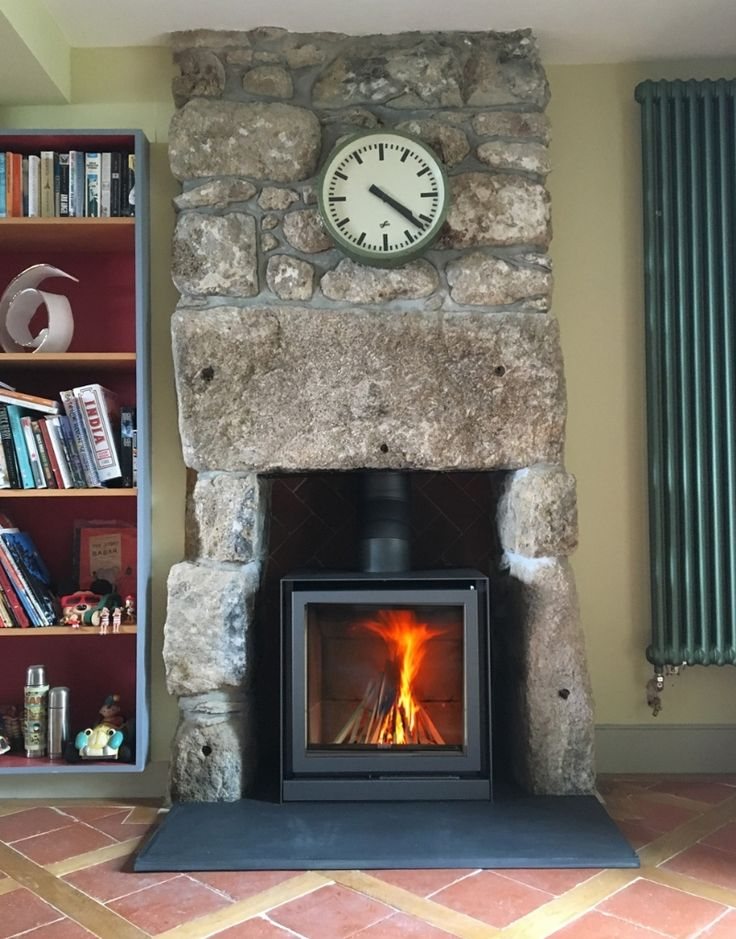 A Stuv 16 cube installed into traditional stone fireplace by Kernow Fires in Cornwall.   #stuv #fire #stove #modern #contemporary #woodburner #traditional #fireplace #slate #hearth #kernowfires #wadebridge #redruth #cornwall