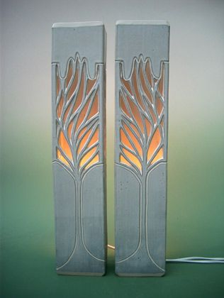 Inspiration for exterior concrete fixtures.  Ray Macro, potter: Tall elegant pierced wall and floor lamps inspired by individual character of the growth patterns of mature trees. Ray has developed a technique of hollow extrusion to achieve these extended forms, creating a localised ambience of light.  Work generally available from: Stokoe House Ceramics Gallery, Alston, Cumbria CA9 3HS